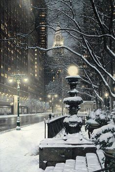 NYC. Snowy night scene in Manhattan with Chrysler Building in the background