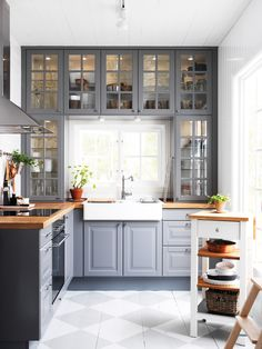 Ikea grey cabinets, option to paint the floor to save money, love the old window look to the upper cabinets, can be country and elegant