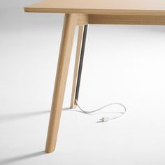 Solem table keeps cables tidy with hidden storage in each leg