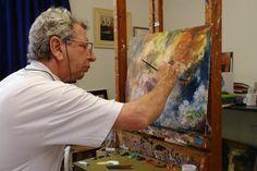 Washington Maguetas painting a picture