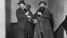 Author Radclyffe Hall, right, and Lady Una Trowbridge with their daschunds at Crufts dog show in Feb. 1923. (Topical Press Agency/Getty Images)
