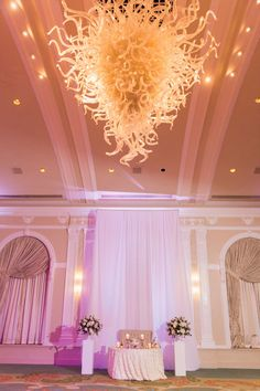 Wedding Reception Sweetheart Table with Large Round Flower Arrangements on White Pedestals and Tall Candle Holders with Artistic Glass Chandelier | Tampa Bay Hotel Ballroom Wedding Venue The Vinoy Renaissance | St Pete Wedding Planner Parties A La Carte
