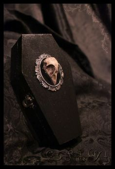 mortisia:    Gothic Coffin Jewelry Skull Cameo trinket box antiqued silver setting velvet damask lining |source