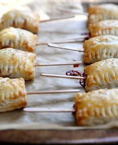 Baked Brie Bites - Christmas or Wine and Cheese Party. I would use quince paste in lieu of jam.
