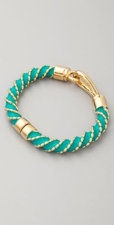 RACHEL LEIGH Singita Eternity Bracelet This hinged, gold-plated bracelet features a loop detail at the twisted, enameled band. Gold Jewelry, Jewelry Box, Jewelery, Gold Plated Bracelets, Bangles, Eternity Bracelet, Jewelry Accessories, Fashion Accessories, Teal And Gold