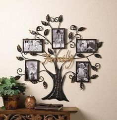 FAMILY TREE PHOTO DECOR Your family tree is beautiful, and you can show it with this unique photo frame wall decor. A metal tree emblazoned with the golden word Family holds 5 of your most precious x family photos. Family Tree Wall Decor, Family Tree Picture Frames, Family Tree With Pictures, Family Tree Photo, Unique Picture Frames, Metal Photo Frames, Frame Wall Decor, Frames On Wall, Unique Photo