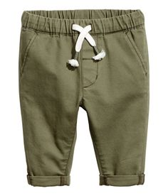 Check this out! Chinos in soft, washed cotton twill. Elasticized drawstring waistband with mock fly. Side pockets and mock welt back pocket. - Visit hm.com to see more.