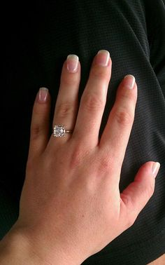 my ring :)   beautiful antique cushion cut diamond solitaire set in white gold. my man knows what I like :)