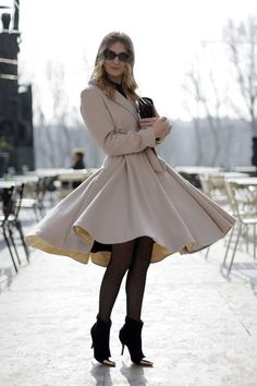 Vogue Brazil's Helena Bordon knows the power of a swishy coat!