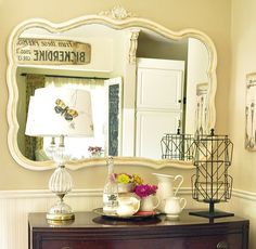 i have this mirror in the garage!!!! it's black and old and i need to re-purpose it!