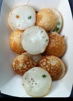 Kanom Krok is an ubiquitous street snack made in the cast iron kanom krok pan. This version is rich, custardy and consistent.