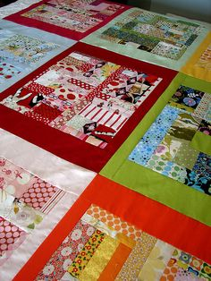 boxed scraps quilt in progress | Flickr - Photo Sharing! Love the use of same colour solids as borders
