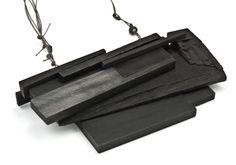 "Julia Turner ""Black Pile"" necklace, 2010. Wood, paint, steel, string. 2.6 x 4 x .7 in (6.4 x 10.16 x 1.9 cm)."