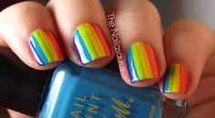 The Nailasaurus rainbow nails.