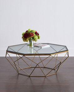 """<ul> <li>Handcrafted coffee table.</li> <li>Iron and glass.</li> <li>Assembly required.</li> <li>44""""W x 41""""D x 16""""T.</li> <li>Imported.</li> </ul>"""