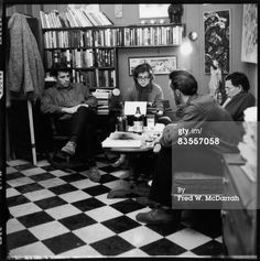 Jack Kerouac, Albert Saijo (with glasses), and Lew Welch collaborate on a poem, typed by Gloria Schoffel in the apartment (304 W. 14th St.) of her and her soon-to-be husband, photographer McDarrah, New York, New York, December 10, 1959. The poem was entitled This is a Poem by Albert Saijo, Lew Welch, and Jack Kerouac (later published as Trip Trap), and was based on the trios journey from San Francisco