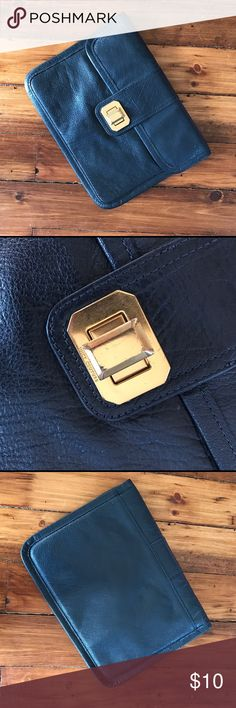 Padded Clutch Juicy Couture clutch. Navy color with gold hardware. I carried it as a bag but I may also be used for electronics. The hardware is worn but the bag is in good condition! Juicy Couture Bags Clutches & Wristlets