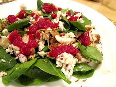 In-Law's Thanksgiving Left Overs Spinach Salad perfect with spinach, cranberry sauce, turkey, and toasted pumpkin seeds.