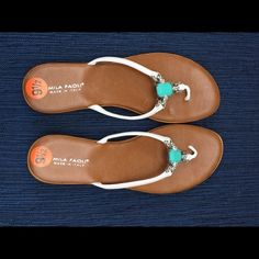 NWOT MILA PAOLI SANDALS 91/2 NWOT Mila Paoli 91/2, made in Italy, detailed design with turquoise color stone. Shown in photo with clear plastic protecting stone on both shoes. Mila Paoli Shoes Sandals