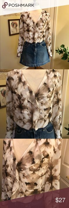 C K Blouse Flirty and fun Blouse by Calvin Klein. Size Medium. Flouncy ruffle down the front. Looks beautiful with jeans and boots or under a jacket to work. Brown and beige watercolor print on ivory. Fully lined. Long sleeves can be rolled and buttoned. Excellent condition. Calvin Klein Tops Blouses