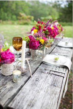 Rustic table with bright colored flowers