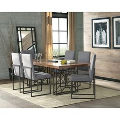 Strong architectural and geometric elements are in play to create this harmonious dining collection. The Chancelor table base has a beautiful puzzle-like pattern, crafted of metal in a dark bronze finish. Table top is stout with a thick top in natural walnut veneer