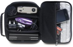 """Electronics Case -- get for J  Make your gear easy to see during an airport X-ray with this hard-sided case that keeps electronics safe and secure with adjustable padding and a zippered pocket for smaller items. Measuring 8½ x 2¾ x 6¼"""", it's $15.99 at magellans.com."""