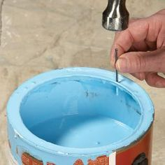 Storing Paint Cans ~ Puncture and drain the can rim. Use a small nail to drive four holes in the rim of the paint can. Let the paint drain back into the can and seal the lid with a block of wood and a hammer. Store the can upside down. Woodworking Projects, Diy Projects, Woodworking Garage, Woodworking Basics, Woodworking Furniture, Paint Stain, Home Repairs, Do It Yourself Home, Paint Cans