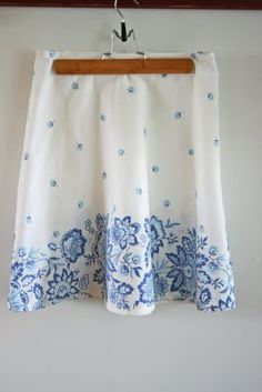 Skirt from table cloth.  The tutorial is here:  http://www.vanessachristenson.com/2009/06/tutorial-table-cloth-skirt.html