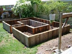 This is what I'd like to have in the back yard. Raised bed design. Raised garden or flower bed. Walk into the walkway and pick from your garden easily.