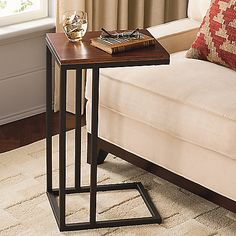 $89 This contemporary Wood Top C Table is perfect for use as an accent table or work station, and will add modern style to any décor. Constructed from powder-coated steel, this sturdy table is shaped like the letter C with an elegant wooden table top.