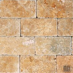 longer tiles though tuscan tumbled stone subway tile- kitchen backsplash. longer tiles though