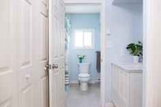 """A lovely shade of light blue and our Yura New Series floor tile make for a refreshing bathroom design.  Bathroom Floor: Yura New Series in Snow White 12""""x24"""" http://olympiatile.com/product/series/22/yura_new"""