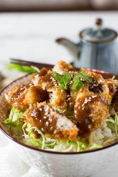 Miso Katsudon is a delicious Donburi (rice bowl) dish made from katsu (fried pork/meat) on top of rice coated with a tasty miso sauce! Pork Recipes, Chicken Recipes, Cooking Recipes, Healthy Recipes, Cooking Ideas, Drink Recipes, Easy Recipes, Recipies, Dinner Recipes