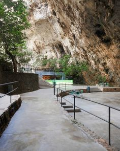 have for Cuevas dels Hams, located in Porto Cristo, Mallorca, designed a beautiful botanic garden entrance to the caves. It is in this entrance that the bar is situated and made up of a piece of backlit glass of fifteen metres in length. Beautiful Islands, Beautiful World, Beautiful Places, Menorca, The Places Youll Go, Places To See, Ibiza, Spain And Portugal, Urban Landscape