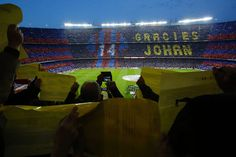 """Football supporters hold-up coloured rectangular posters to form a giant mosaic reading, """"Thankyou Johan"""", in tribute to late Dutch football player Johan Cruyff before the Spanish league """"Clasico"""" football match FC Barcelona vs Real Madrid CF at the Camp Nou stadium in Barcelona on April 2, 2016."""