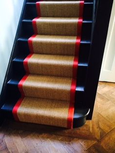 Sisal Stair runner with red binding by B&R Carpet Company – Runner Rugs Entryway Painted Staircases, Painted Stairs, Wooden Stairs, Spiral Staircases, Painted Floors, Painted Wood, Deck Stair Lights, Stair Lighting, Wall Carpet