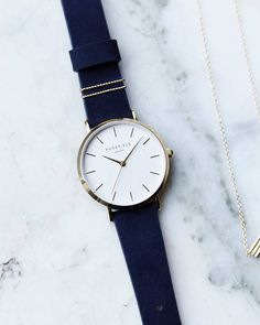 Channel a feminine, cool vibe with the Velvet Blue strap wrapped with two twisted gold-tone rings. Channel a feminine, cool vibe with the Velvet Blue strap wrapped with two twisted gold-tone rings. Stylish Watches For Girls, Trendy Watches, Watches For Men, Girl Watches, Cheap Watches, Cute Jewelry, Jewelry Accessories, Fashion Accessories, Women Jewelry