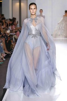 Powder blue chiffon gown and cape overlaying crystal chainmail bustier, edged with crystal and pearl pendant embroidery.