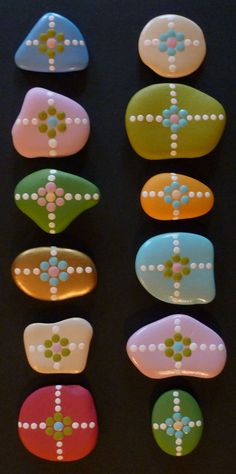 Bright acrylic painted pebbles. I could use nail varnish?