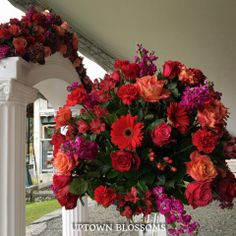 Vibrant wedding ceremony flowers in corals, deep hot pinks and reds. Wedding Ceremony Flowers, Same Day Flower Delivery, Hot Pink, Vibrant Colors, Floral Design, Floral Wreath, Bouquet, Corals, Blossoms