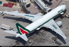 High quality photo of EI-ISB (CN: 32859) Alitalia Boeing 777-243(ER) by Claus Witte | Interested in free comics or health and fitness guides? Visit our partner site for free downloads. Visit http://www.cavemenworld.com/cavemenmedia/