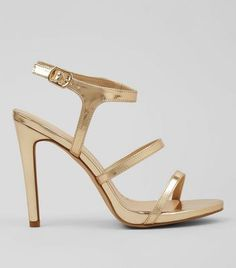 - Gold metallic finish- Triple strap design- Open toe- Ankle strap fastening- Stiletto heel