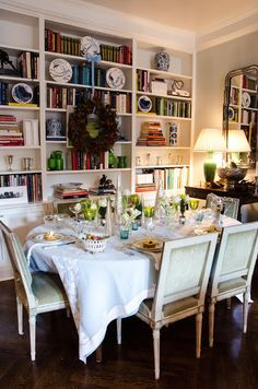 Dining room & library combo in chic Gramercy Park apartment of Bunny Williams protege, CeCe Thompson