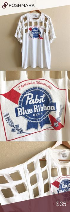 PBR Gridlock Tee Perfectly worn Pabst Blue Ribbon Beer tee with grid cutout. One of a kind!  BRAND:  MATERIAL:  YEAR/ERA: 90s LABEL SIZE: 2X BEST FIT:   MEASUREMENTS: Chest inches Length inches   *Listed as LF for search visibility. *Price firm unless bundled.  🚫 I do not model or trade, sorry! 💟 Check out my closet for more vintage tees!     0053 LF Tops Tees - Short Sleeve