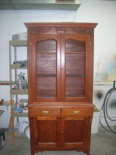 This beautifully refinished cabinet came to us in pieces. It had been painted white. It was very difficult to get all of the white paint out. We brought this cabinet back to life. You never know what beautiful wood you will find under a painted piece.  Thanks to our customer she saw the potential and had this completely refinished. Please let me know what you think of our work. Furniture Repair by Fry's- Wichita 316-239-3145, Newton 316-283-7650. Thank you for looking and have a blessed day.