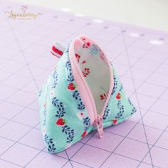 "Here's my sewing tutorial for this cute little pyramid pouch!  The finished size measures 3½"". Basic Material Requirements: Scissors, rotary cutter, rulers, sewing thread, pins or clips, sewing machine 7-inch Zipper (one)  I make so many of these that I buy zippers in bulk, so I will always have them on hand.  (Zippers are really cheap …"