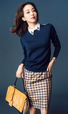Embroidered shirt,navy pullover and plaid pencil skirt.Work look.