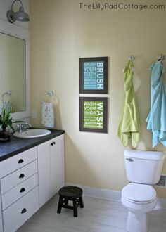 Kids Bathroom Makeover- www.thelilypadcottage.com. I like the green & blue $ our wall is already that color....and the blue would tie into their bedrooms