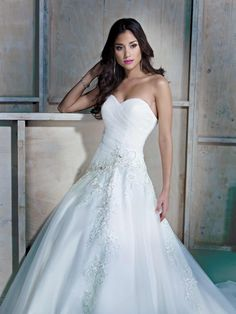 This beautiful Ella Rosa asymmetrical princess gown in ivory provides a beautiful and supportive shape with its sweetheart cut corset top. Elegant, subtle beading in front provides the perfect amount of shimmer.